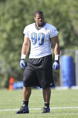 ALLEN PARK, MI - JULY 30:  Ndamukong Suh #90 of the Detroit Lions takes a break during training camp at the Lions facility on July 30, 2011 in Allen Park, Michigan.  (Photo by Leon Halip/Getty Images)