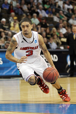 DENVER, CO - MARCH 17:  Peyton Siva #3 of the Louisville Cardinals handles the ball against the Morehead State Eagles during the second round of the 2011 NCAA men's basketball tournament at Pepsi Center on March 17, 2011 in Denver, Colorado.  (Photo by Ju