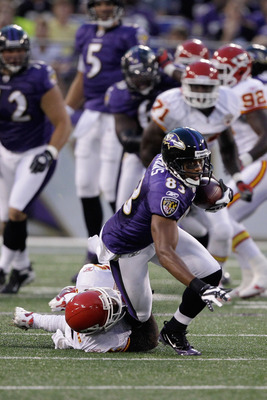 BALTIMORE, MD - AUGUST 19: Wide receiver Lee Evans #83 of the Baltimore Ravens is tackled by  Brandon Flowers #24 of the Kansas City Chiefs during the first half of a preseason game at M&T Bank Stadium on August 19, 2011 in Baltimore, Maryland.  (Photo by