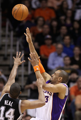 PHOENIX, AZ - APRIL 13:  Grant Hill #33 of the Phoenix Suns puts up a shot against the San Antonio Spurs during the NBA game at US Airways Center on April 13, 2011 in Phoenix, Arizona.  NOTE TO USER: User expressly acknowledges and agrees that, by downloa