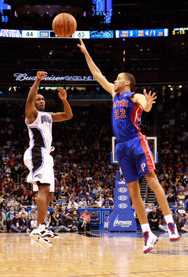 ORLANDO, FL - JANUARY 24:  Tayshaun Prince #22 of the Detroit Pistons attempts to block the pass of Gilbert Arenas #1 of the Orlando Magic during the game at Amway Arena on January 24, 2011 in Orlando, Florida.  NOTE TO USER: User expressly acknowledges a