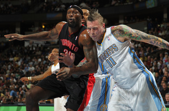 DENVER, CO - MARCH 21:  Chris Andersen #11 of the Denver Nuggets battles for position with Reggie Evans #30 of the Toronto Raptors at the Pepsi Center on March 21, 2011 in Denver, Colorado. NOTE TO USER: User expressly acknowledges and agrees that, by dow
