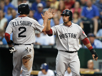 KANSAS CITY, MO - AUGUST 18:  Jacoby Ellsbury #2 of the Boston Red Sox and Mike Aviles celebrate after scoring on a Dustin Pedroia single in the third inning at Kauffman Stadium on August 18, 2011 in Kansas City, Missouri. (Photo by Ed Zurga/Getty Images)