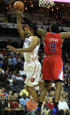 CHARLOTTE, NC - MARCH 07:  DeAndre Jordan #9 of the Los Angeles Clippers tries to stop Dominic McGuire #5 of the Charlotte Bobcats during their game at Time Warner Cable Arena on March 7, 2011 in Charlotte, North Carolina. NOTE TO USER: User expressly ack