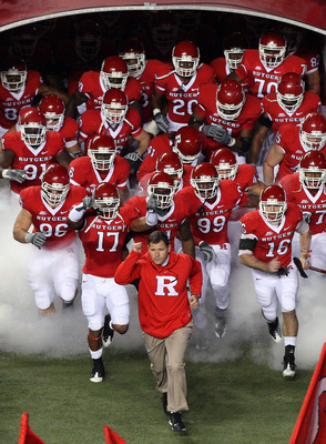 PISCATAWAY, NJ - NOVEMBER 12:  Head coach Greg Schiano of the Rutgers Scarlet Knights leads his team on the field to play against the South Florida Bulls at Rutgers Stadium on November 12, 2009 in Piscataway, New Jersey.  (Photo by Jim McIsaac/Getty Image