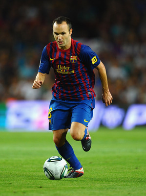 BARCELONA, SPAIN - AUGUST 17:  Andres Iniesta of Barcelona in action during the Super Cup second leg match between Barcelona and Real Madrid at Nou Camp on August 17, 2011 in Barcelona, Spain.  (Photo by Laurence Griffiths/Getty Images)