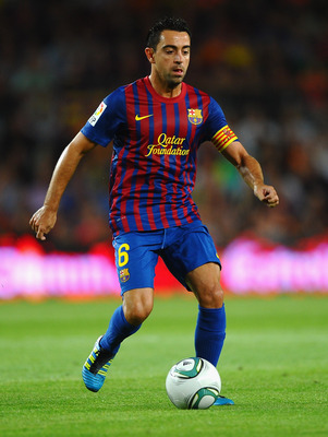 BARCELONA, SPAIN - AUGUST 17: Xavi of Barcelona in action during the Super Cup second leg match between Barcelona and Real Madrid at Nou Camp on August 17, 2011 in Barcelona, Spain.  (Photo by Laurence Griffiths/Getty Images)