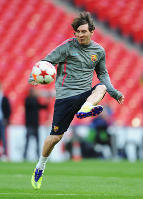 LONDON, ENGLAND - MAY 27:  Lionel Messi of FC Barcelona controls the ball during a Barcelona training session prior to the UEFA Champions League final versus Manchester United at Wembley Stadium on May 27, 2011 in London, England.  (Photo by Jasper Juinen