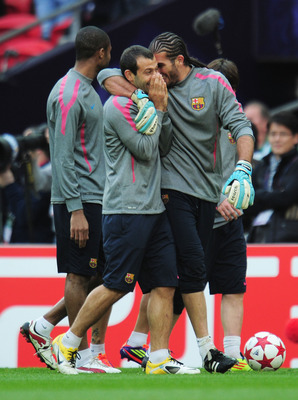 LONDON, ENGLAND - MAY 27:  Jose Manuel Pinto of FC Barcelona (R) embraces teammateJavier Mascherano during a Barcelona training session prior to the UEFA Champions League final versus Manchester United at Wembley Stadium on May 27, 2011 in London, England