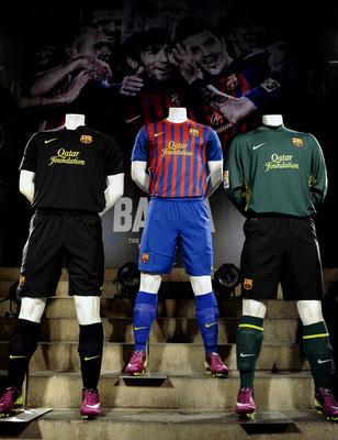 BARCELONA, SPAIN - MAY 17:  The new FC Barcelona shirt is displayed during the official presentation at Nou Camp Stadium on May 17, 2011 in Barcelona, Spain.  (Photo by David Ramos/Getty Images)