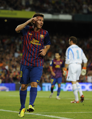 BARCELONA, SPAIN - AUGUST 22:  Lionel Messi of FC Barcelona celebrates after scoring his fifth team's goal during the Joan Gamper Trophy match between FC Barcelona and SSC Napoli at the Camp Nou Stadium on August 22, 2011 in Barcelona, Spain.  (Photo by D
