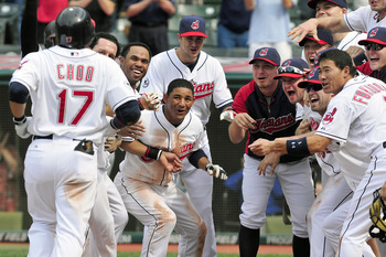 CLEVELAND, OH - AUGUST 23: Shin-Soo Choo #17 of the Cleveland Indians is greeted by his teammates after hitting a three run walk-off home run against the Seattle Mariners to win the game 7-5 at Progressive Field on August 23, 2011 in Cleveland, Ohio. (Pho