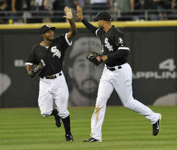 CHICAGO, IL - AUGUST 20: Juan Pierre #1 of the Chicago White Sox and Alex Rios #51celebrate the Sox victory on August 20, 2011 at U.S. Cellular Field in Chicago, Illinois. The White Sox defeated the Rangers 3-2.  (Photo by David Banks/Getty Images)