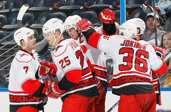 ATLANTA, GA - DECEMBER 16:  Eric Staal #12 of the Carolina Hurricanes celebrates his goal against the Atlanta Thrashers with Ian White #7, Joni Pitkanen #25 and Jussi Jokinen #36 at Philips Arena on December 16, 2010 in Atlanta, Georgia.  (Photo by Kevin