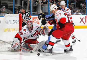ATLANTA, GA - FEBRUARY 13:  Joe Corvo #77 defends as goaltender Cam Ward #30 of the Carolina Hurricanes saves a shot on goal by Anthony Stewart #22 at Philips Arena on February 13, 2011 in Atlanta, Georgia.  (Photo by Kevin C. Cox/Getty Images)