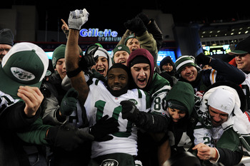 FOXBORO, MA - JANUARY 16:  Santonio Holmes #10 of the New York Jets celebrates with fans after the Jets defeated the Patriots 28 to 21 in their 2011 AFC divisional playoff game at Gillette Stadium on January 16, 2011 in Foxboro, Massachusetts.  (Photo by