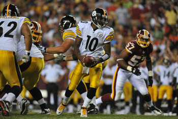 LANDOVER, MD - AUGUST 12:  Dennis Dixon #10 of the Pittsburgh Steelers hands off against the Washington Redskins at FedExField on August 12, 2011 in Landover, Maryland. The Redskins defeated the Steelers 16-7 at the half. (Photo by Larry French/Getty Imag