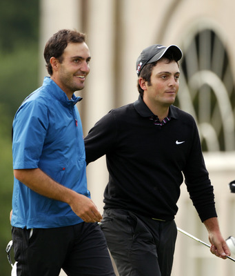 LUSS, SCOTLAND - JULY 11:  Edoardo Molinari of Italy (L) walks off the 18th green with his brother Francesco Molinari after winning The Barclays Scottish Open at Loch Lomond Golf Club on July 11, 2010 in Luss, Scotland.  (Photo by Andrew Redington/Getty I