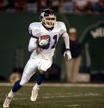 20 Aug 1998:  Jason Sehorn #31 of the New York Giants runs with the ball before injuring himself on the play during a pre-season game against the New York Jets at the Giants Stadium in East Rutherford, New Jersey. The Jets defeated the Giants 27-23.