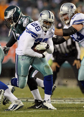 PHILADELPHIA, PA - JANUARY 02:  Felix Jones #28 of the Dallas Cowboys runs the ball against the Philadelphia Eagles on January 2, 2011 at Lincoln Financial Field in Philadelphia, Pennsylvania.  (Photo by Jim McIsaac/Getty Images)