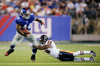 EAST RUTHERFORD, NJ - AUGUST 22:  Ahmad Bradshaw #44 of the New York Giants is tackled by Tim Jennings #26 of the Chicago Bears during a pre season game at New Meadowlands Stadium on August 22, 2011 in East Rutherford, New Jersey.  (Photo by Patrick McDer