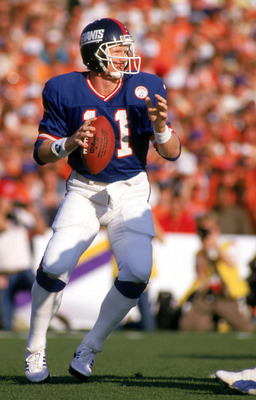 PASADENA, CA - JANUARY 25:  Quarterback Phil Simms #11 of the New York Giants drops back to pass against the Denver Broncos during Super Bowl XXI at the Rose Bowl on January 25, 1987 in Pasadena, California. The Giants defeated the Broncos 39-20. (Photo b