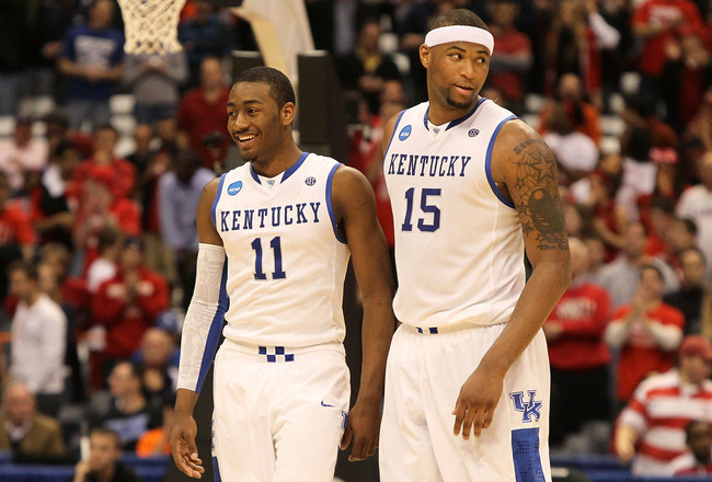 SYRACUSE, NY - MARCH 25:  (L-R) John Wall #11 and DeMarcus Cousins #15 of the Kentucky Wildcats react late in the second half against the Cornell Big Red during the east regional semifinal of the 2010 NCAA men's basketball tournament at the Carrier Dome o