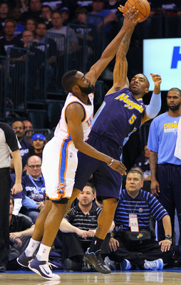 OKLAHOMA CITY, OK - APRIL 27: James Harden #13 of the Oklahoma City Thunder knocks the ball away from J.R. Smith #5 of the Denver Nuggets in Game Five of the Western Conference Quarterfinals in the 2011 NBA Playoffs on April 27, 2011 at the Ford Center in