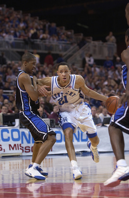 ST. LOUIS - MARCH 16:  Forward Tayshaun Prince #21 of the Kentucky Wildcats drives to the basket while guard Jason Parker #14 of the Tulsa Golden Hurricanes defends during the second round of the 2002 NCAA Division I Men's Basketball Tournament on March 1