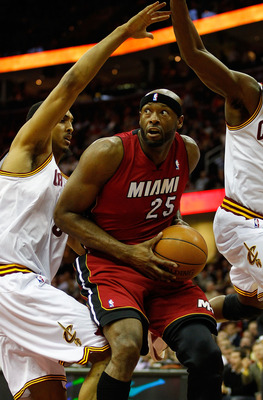 CLEVELAND - MARCH 29: Erick Dampier #25 of the Miami Heat is surrounded by Cleveland Cavaliers defenders during the game on March 29, 2011 at Quicken Loans Arena in Cleveland, Ohio. NOTE TO USER: User expressly acknowledges and agrees that, by downloading