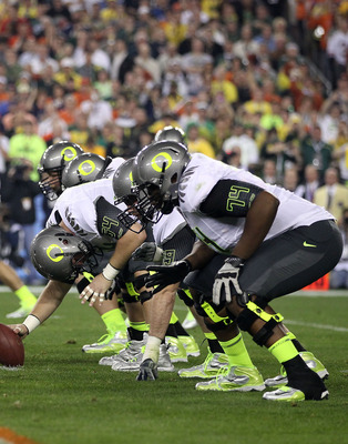 GLENDALE, AZ - JANUARY 10:  Center Jordan Holmes #54 of the Oregon Ducks prepares to snap the ball against the Auburn Tigers during the Tostitos BCS National Championship Game at University of Phoenix Stadium on January 10, 2011 in Glendale, Arizona.  (Ph