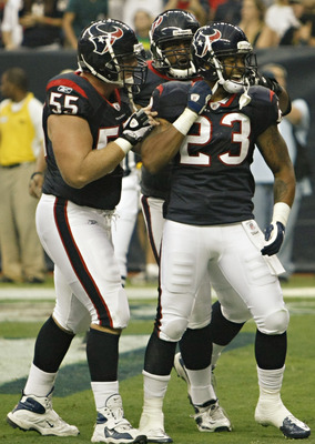 HOUSTON - AUGUST 20:  Running back Arian Foster #23 of the Houston Texans celebrates with center Chris Myers #55 after scoring in the first quarter against the New Orleans Saints at Reliant Stadium on August 20, 2011 in Houston, Texas.  (Photo by Bob Leve