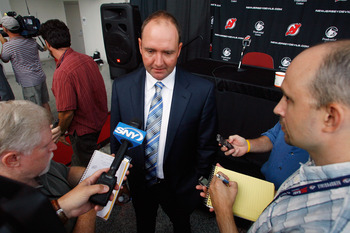 NEWARK, NJ - JULY 19: Peter DeBoer is interviewed by the media after being named the new head coach of the New Jersey Devils at a press conference on July 19, 2011 in Newark, New Jersey. (Photo by Andy Marlin/Getty Images)