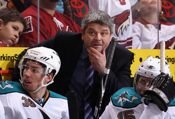 GLENDALE, AZ - JANUARY 17:  Head coach Todd McLellan of the San Jose Sharks watches from the bench during the NHL game against the Phoenix Coyotes at Jobing.com Arena on January 17, 2011 in Glendale, Arizona.  The Sharks defeated the Coyotes 4-2. (Photo b