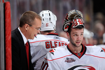 WASHINGTON - NOVEMBER 28:  Head coach Paul Maurice of the Carolina Hurricanes talks with Cam Ward #30 before the shootout against the Washington Capitals at the Verizon Center on November 28, 2010 in Washington, DC.  (Photo by Greg Fiume/Getty Images)