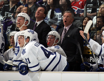 LOS ANGELES, CA - JANUARY 10: Head coach Ron Wilson (R) of the Toronto Maple Leafs reacts to a scoreboard video replay during the game against the Los Angeles Kings at the Staples Center on January 10, 2011 in Los Angeles, California. The Leafs defeated t