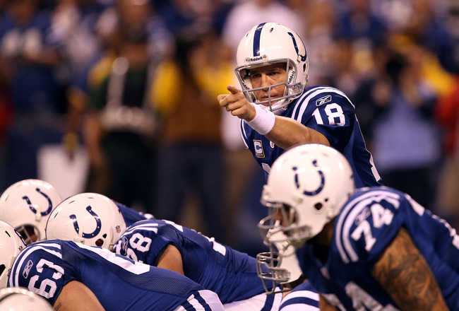 INDIANAPOLIS, IN - JANUARY 08:  Peyton Manning #18 of the Indianapolis Colts gestures a she calls signals out at the line of scrimmage against the New York Jets during their 2011 AFC wild card playoff game at Lucas Oil Stadium on January 8, 2011 in Indian