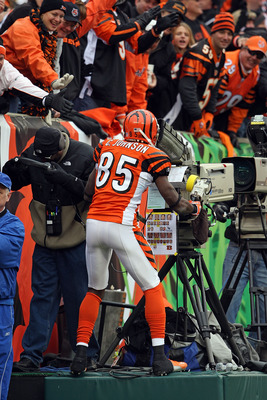 CINCINNATI - NOVEMBER 25:  Chad Johnson #85 of the Cincinnati Bengals celebrates after catching a touchdown pass by taking over a television camera during the NFL game against the Tennessee Titans on November 25, 2007 at Paul Brown Stadium in Cincinnati,