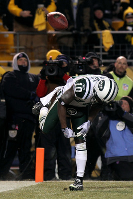PITTSBURGH, PA - JANUARY 23:  Santonio Holmes #10 of the New York Jets spikes the ball as he celebrates after he scored a third quarter touchdown against the Pittsburgh Steelers during the 2011 AFC Championship game at Heinz Field on January 23, 2011 in P