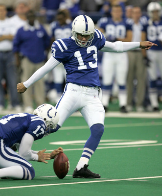 INDIANAPOLIS - NOVEMBER 8:  Mike Vanderjagt #13 of the Indianapolis Colts kicks the game-winning field goal against the Minnesota Vikings as holder Hunter Smith #17 places the ball on November 8, 2004 at the RCA Dome in Indianapolis, Indiana. The Colts de