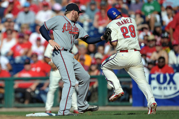 PHILADELPHIA, PA - JULY 09: Raul Ibanez #29 of the Philadelphia Phillies gets tagged out at first base by Freddie Freeman #5 of the Atlanta Braves at Citizens Bank Park on July 9, 2011 in Philadelphia, Pennsylvania. The Braves won 4-1. (Photo by Drew Hall