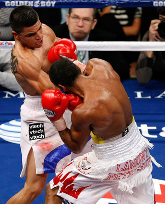 LAS VEGAS - DECEMBER 11:  (L-R) Victor Ortiz throws a right to the face of Lamont Petersen during the super lightweight fight at Mandalay Bay Events Center on December 11, 2010 in Las Vegas, Nevada.  (Photo by Ethan Miller/Getty Images)