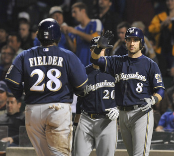 CHICAGO, IL - JUNE 15: Ryan Braun #8 of the Milwaukee Brewers and Prince Fielder #28 celebrate after scoring in the seventh inning against the Chicago Cubs on June 15, 2011 at Wrigley Field in Chicago, Illinois.  (Photo by David Banks/Getty Images)