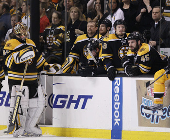 BOSTON - MAY 14:  Tuukka Rask #40 and the rest of the Boston Bruins react as the Philadelphia Flyers celebrate the win in Game Seven of the Eastern Conference Semifinals during the 2010 NHL Stanley Cup Playoffs at TD Garden on May 14, 2010 in Boston, Mass