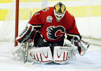 CALGARY, CANADA - JUNE 5:  Miikka Kiprusoff #34 of the Calgary Flames makes a save against the Tampa Bay Lightning in game six of the 2004 NHL Stanley Cup Finals on June 5, 2004 at the Pengrowth Saddledome in Calgary, Canada.  (Photo by Jeff Gross/Getty I
