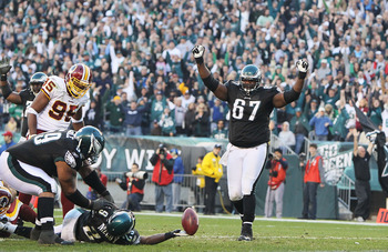 PHILADELPHIA - NOVEMBER 29:  LeSean McCoy #29 of the Philadelphia Eagles ties the game with a two-point conversion against  the Washington Redskins as teammates Jamaal Jackson #67 and Nick Cole #59 celebrate during their game at Lincoln Financial Field on