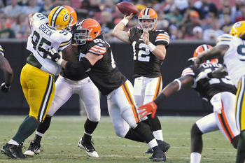 CLEVELAND, OH - AUGUST 13: Starting quarterback Colt McCoy #12 of the Cleveland Browns passes during the first quarter against the Green Bay Packers at Cleveland Browns Stadium on August 13, 2011 in Cleveland, Ohio. The Browns defeated the Packers 27-17.