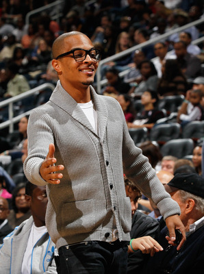 ATLANTA - OCTOBER 21:  Rapper T.I. looks on during the game between the Miami Heat and the Atlanta Hawks at Philips Arena on October 21, 2010 in Atlanta, Georgia.  (Photo by Kevin C. Cox/Getty Images)