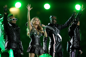 ARLINGTON, TX - FEBRUARY 06:  (L-R) apl.de.ap, Fergie, will.i.am, and Taboo of the Black Eyed Peas perform during the Bridgestone Super Bowl XLV Halftime Show at Cowboys Stadium on February 6, 2011 in Arlington, Texas.  (Photo by Ronald Martinez/Getty Ima