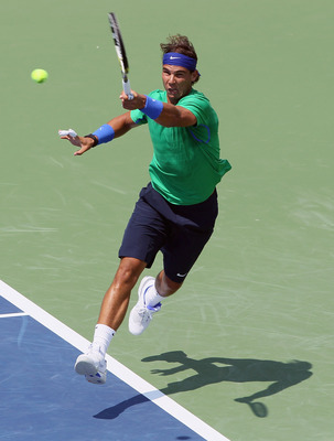MASON, OH - AUGUST 17:  Rafael Nadal of Spain returns a shot Julien Benneteau of France during the Western & Southern Open at the Lindner Family Tennis Center on August 17, 2011 in Mason, Ohio.  (Photo by Elsa/Getty Images)